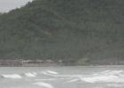 Фото туриста. вид на пляже, только дождь.